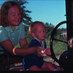 Mom & nephhew Nick on Grandpa's tractor